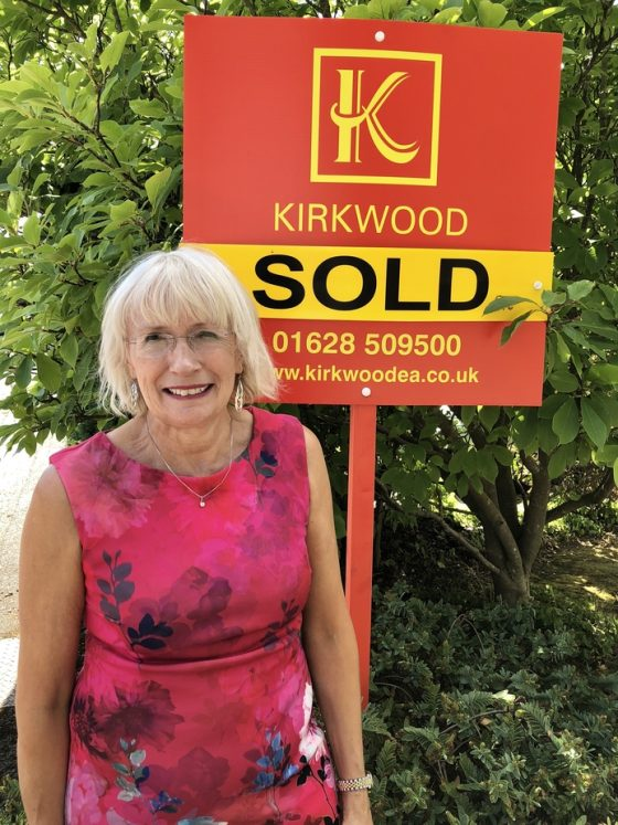 Suzy Kirkwood, Director of Kirkwoods Personal Estate Agents outside a sold property in Cranbrook Drive